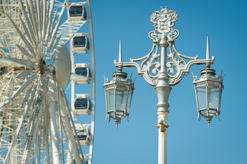 victorian street lamp with ferris wheel in the background