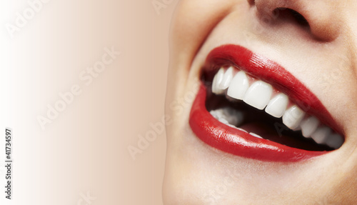 Woman smiling with great teeth on white background