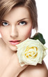 young beautiful girl with perfect skin  and a rose