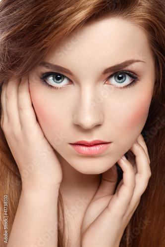 Close-up portrait of an attractive red-haired girl