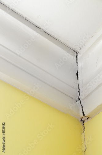crack in a house wall and ceiling