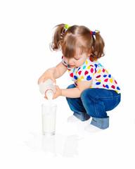 little girl pours milk