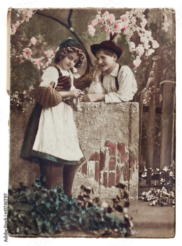 CIRCA 1920.Antique postcard: two children.