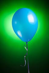 festive blue balloon on green