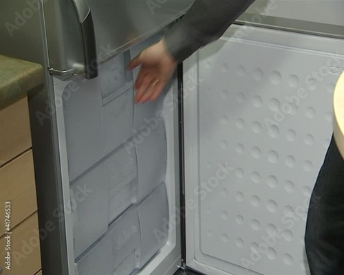 refrigerator door drawers opening. product demonstration shop