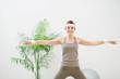 Healthy woman making gymnastics