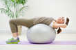 Fitness woman doing abdominal crunch on fitness ball