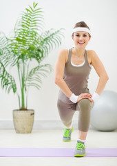 Happy fitness woman squatting