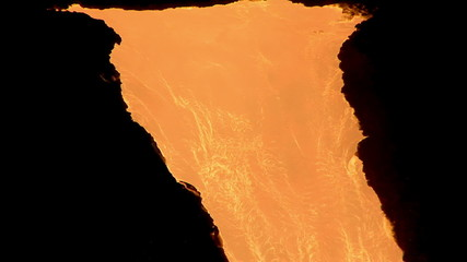 The flow of hot molten metal. Lava