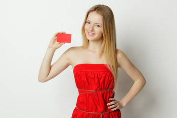Young smiling woman holding business card