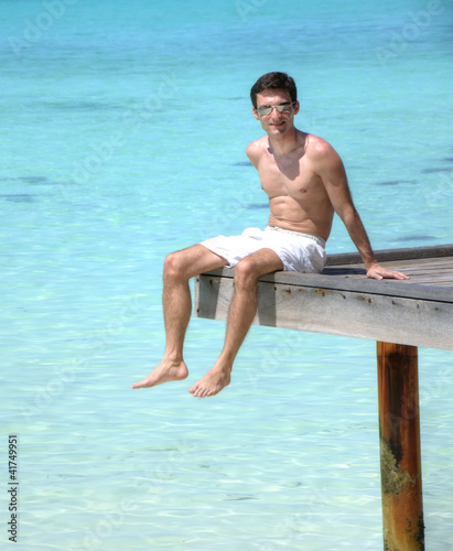 Man sitting on a jetty (Maldives)
