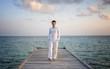Man standing on a jetty (Maldives)