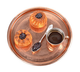 Delicious muffins with blueberry jam on metallic copper tray