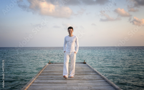Man standing on a jetty (Maldives)