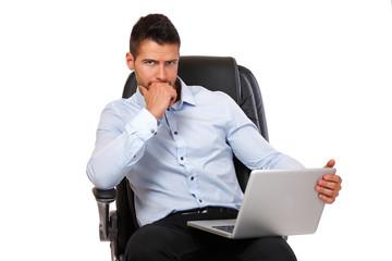 portrait of a businessman with laptop