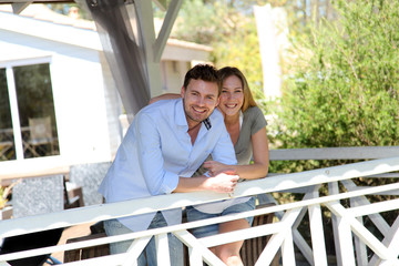 Smiling couple standing in private home gazebo