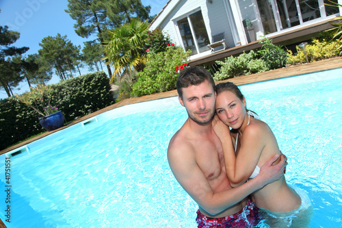 Young couple in private swimming pool