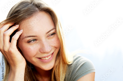 Portrait of beautiful blond smiling woman