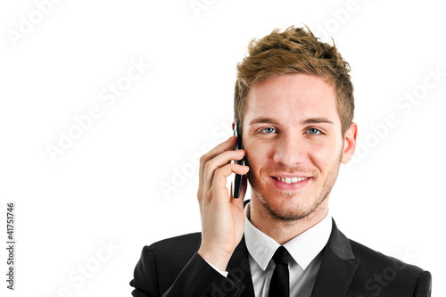 Handsome young businessman at phone