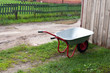 Wheelbarrow gardening tool on green grass