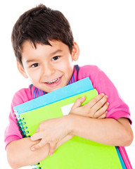 Boy carrying notebooks
