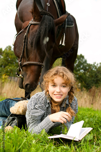 beautiful girl feeds a horse with sugar