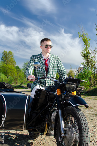 Classy guy on a motorcycle with a sidecar