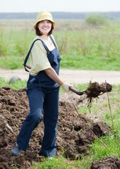 farmer spreads manure