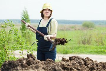 farmer spreads manure at field