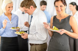 Fototapety Smiling business woman during company lunch buffet