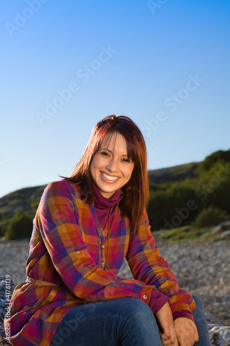Confident Woman Sitting and Smiling