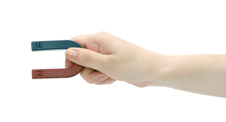 Magnet in a female hand.