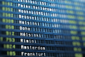 Flights information board in airport terminal