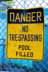 Danger No Trespassing Pool Filled Sign Outside Pool