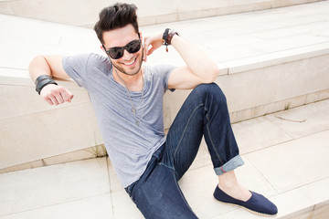 attractive man dressed casual posing outdoors