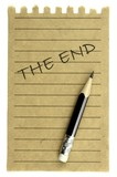 "Handwriting "" The End "" on a natural note paper and pencil"
