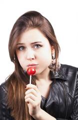 Portrait of sensual pretty woman holding lollipop caramel