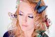 Face of a beautiful woman butterflies in hair