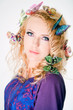 Beautiful woman with butterflies in hair