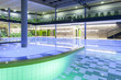 indoor swimming pool with green interior and illumination