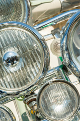 multiple headlight assembly on a retro motorcycle scooter