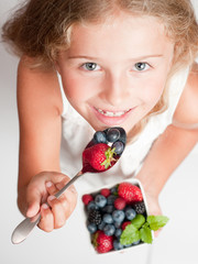 Berries time - lovely girl eating fresh berries