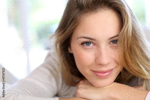 Beautiful young woman with blue eyes