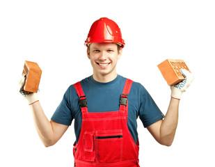 Cheerful builder holding bricks