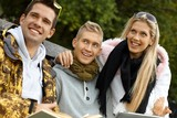 Outdoor portrait of young companionship smiling poster