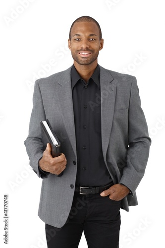 Smart black businessman with organizer