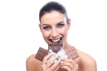Happy woman biting chocolate