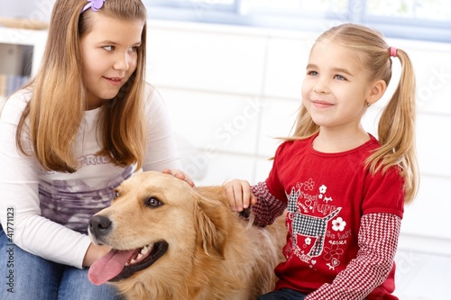 Little girls with dog at home