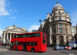 London street with red double decker bus