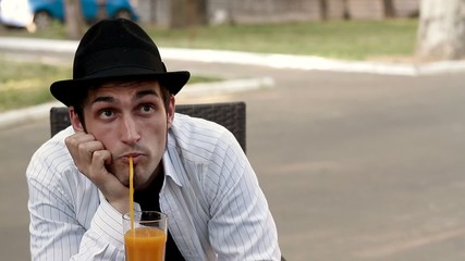 Man in a cafe drinking juice